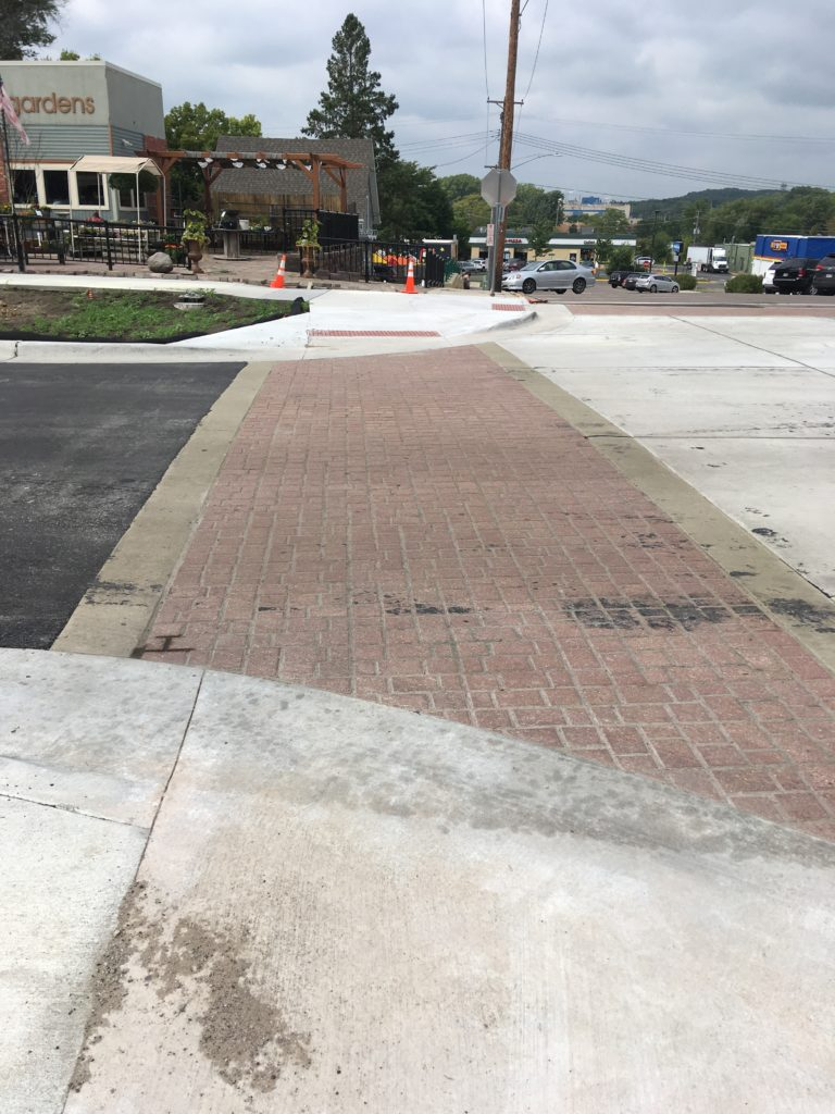 Crosswalk showing curb extensions and pavers
